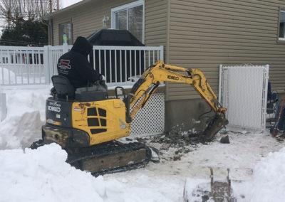 Mini excavation dans endroit restreint à Laval - Alain Fissure à Mascouche